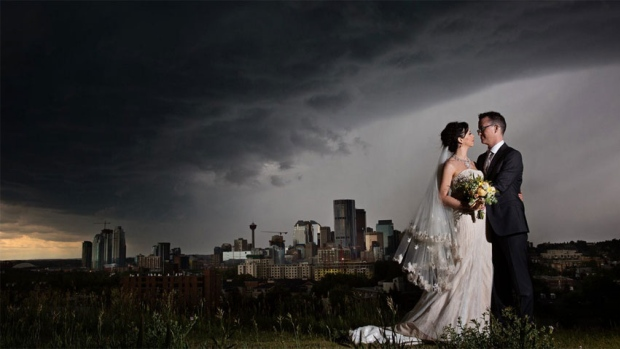 Helen Knight and Owen Chan got caught in the Calgary storm over the weekend just before their wedding reception, and they have this photo to prove it.