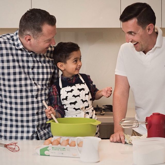 These Dads teaching their son how to cook