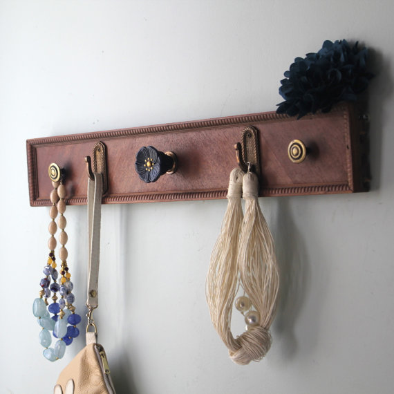 Use the front panels of the drawers to make beautiful hooks for your foyer or bathroom.