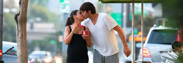 *EXCLUSIVE* **SHOT ON 6/7/14** Sherman Oaks, CA - After a low key lunch date at Casa Vega Ashton Kutcher and Mila Kunis stop by  Menchies frozen yogurt in Sherman Oaks for a snack. The expecting couple shared a kiss as they walked back to their car together. The two appeared to have been getting some exercise earlier in their day, Ashton wore a white v-neck t-shirt and shorts with neon sneakers while pregnant Mila wore spandex pants a black tank top and a large diamond ring. AKM-GSI          June  8, 2014 To License These Photos, Please Contact : Steve Ginsburg (310) 505-8447 (323) 423-9397 steve@akmgsi.com sales@akmgsi.com or Maria Buda (917) 242-1505 mbuda@akmgsi.com ginsburgspalyinc@gmail.com
