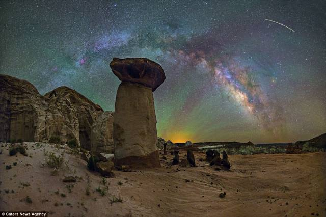 Toadstool rocks, in Page, Arizona, are perfectly framed by the Milky Way and a golden glow at sunrise