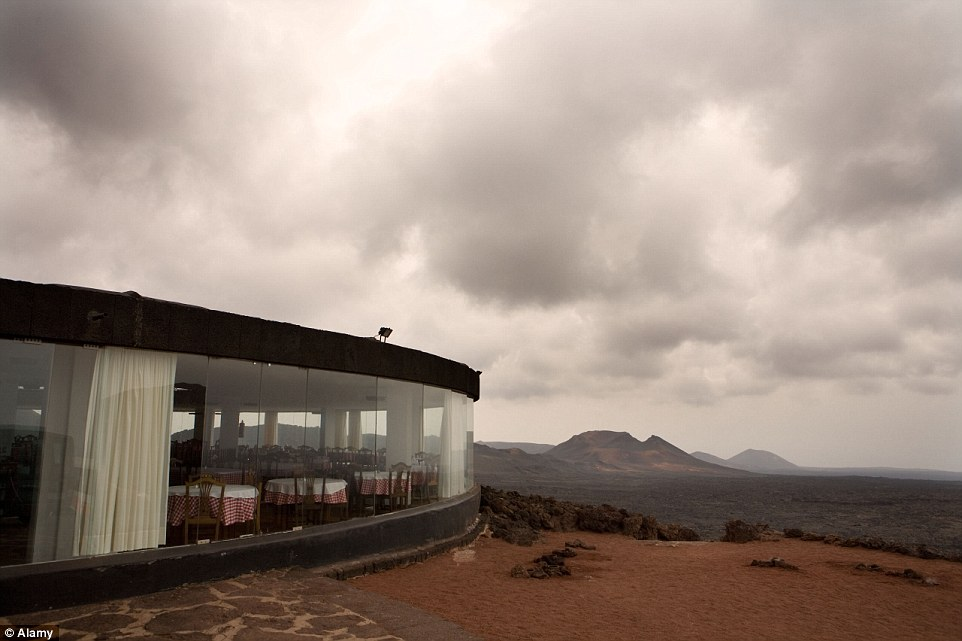 Enjoy panoramic volcanic landscape shots at this unique restaurant in the Canary Islands in Spain