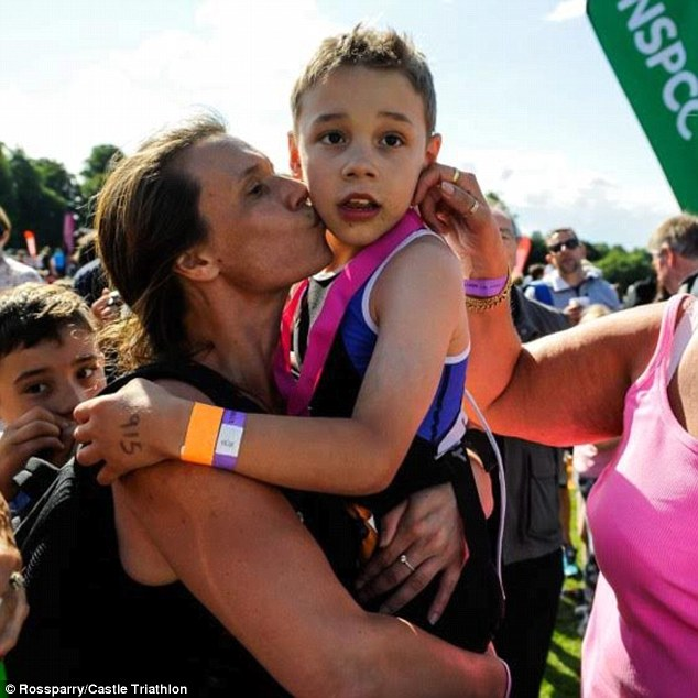Eight-year-old Bailey celebrates with his mother Julie at the finishing line of the Castle Howard Triathlon