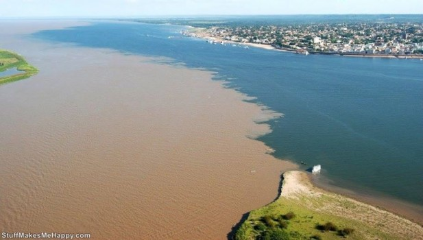 Confluence of the Rio Negro and the Rio Solimoes near Manaus, Brazil