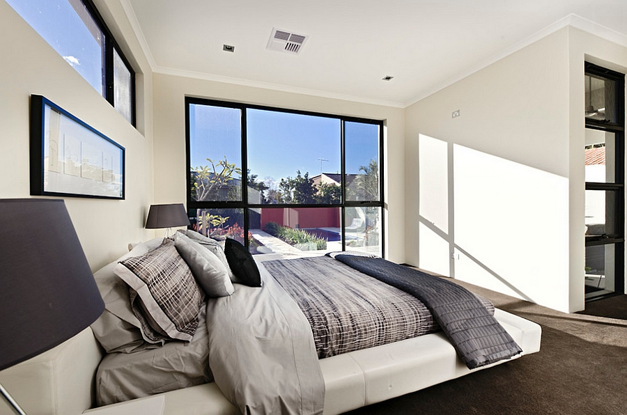 Serene-and-elegant-bedroom-in-white-with-a-viusally-connectivity-with-the-outdoors