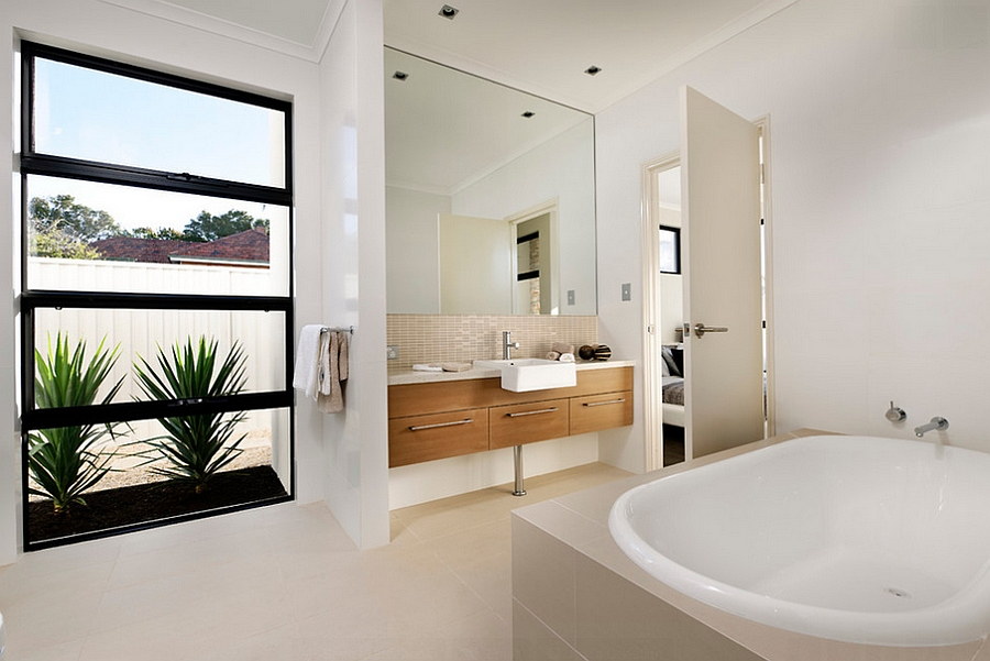 Wooden-vanity-and-natural-greenery-give-the-bath-a-relaxing-trendy-look