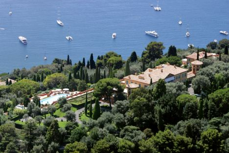 "TO GO WITH AFP STORY IN FRENCH: ""VILLA LEOPOLDA: LA JUSTICE TRANCHE LUNDI SUR LE LITIGE PROKHOROV/SAFRA"" (FILES) -File picture of the Leopolda estate, owned by Lily Safra,the widow of Lebanese-Jewish banking billionaire Edmond safra, taken in Villefranche-sur-Mer, French Riviera on August 9, 2008. The estate was sold to Russian billionaire Mikhail Prokhorov for 370 million Euros, plus 19,5 million Euros for the furniture in August 2008 but later the Russian magnate refused to clinch the deal. French justice will hand over its verdict on March 1, 2010 on the case opposing both parties for an amount of 39 million Euros claimed by the seller. Originally built by King Leopold II of Belgium at the beginning of 1900, the cream-colored villa is set in 20 acres of gardens overlooking Cap Ferrat, near Villefranche sur Mer. AFP PHOTO ERIC ESTRADE/FILES (Photo credit should read ERIC ESTRADE/AFP/Getty Images)"