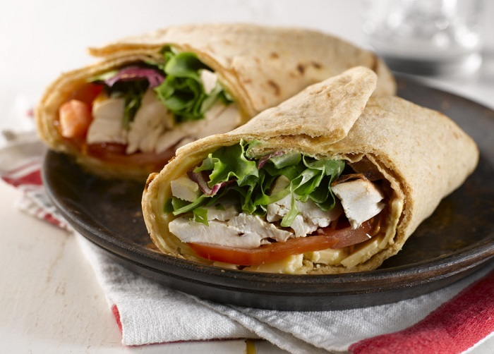 Photo Credit http://www.santoshfreshbaked.ca/uncategorized/santosh-roasted-chicken-cheese-and-tomato-roti-wrap/