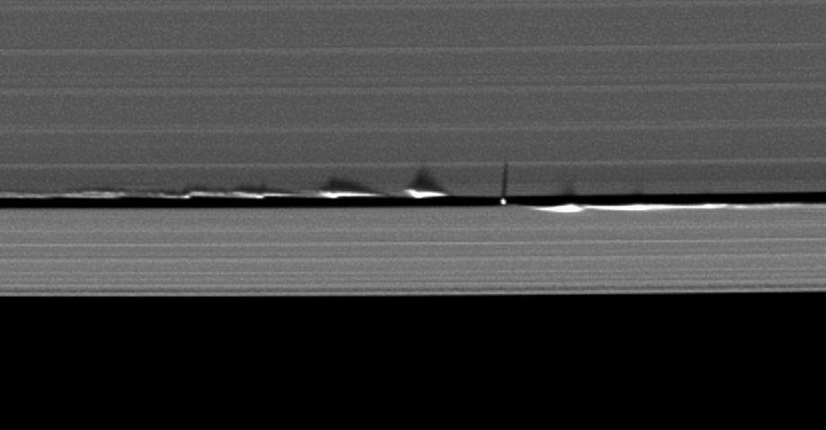 The moon Daphnis' gravity creates vertical waves in the Keeler Gap.