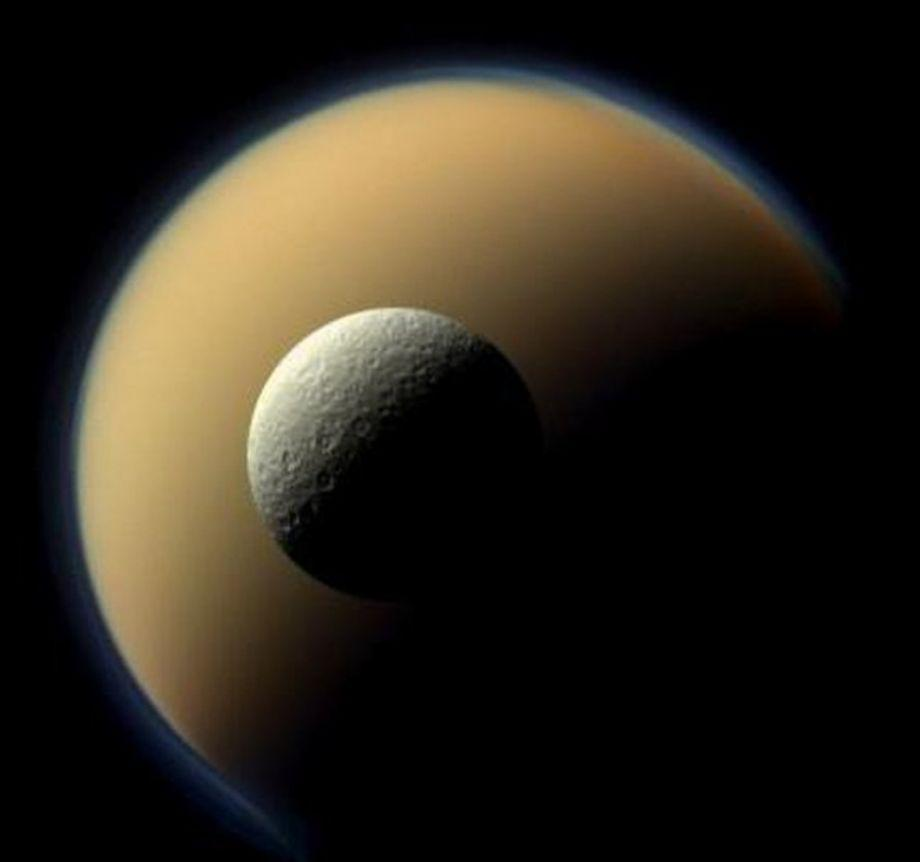 Rhea, Saturn's second largest moon passes in front of the largest, Titan.