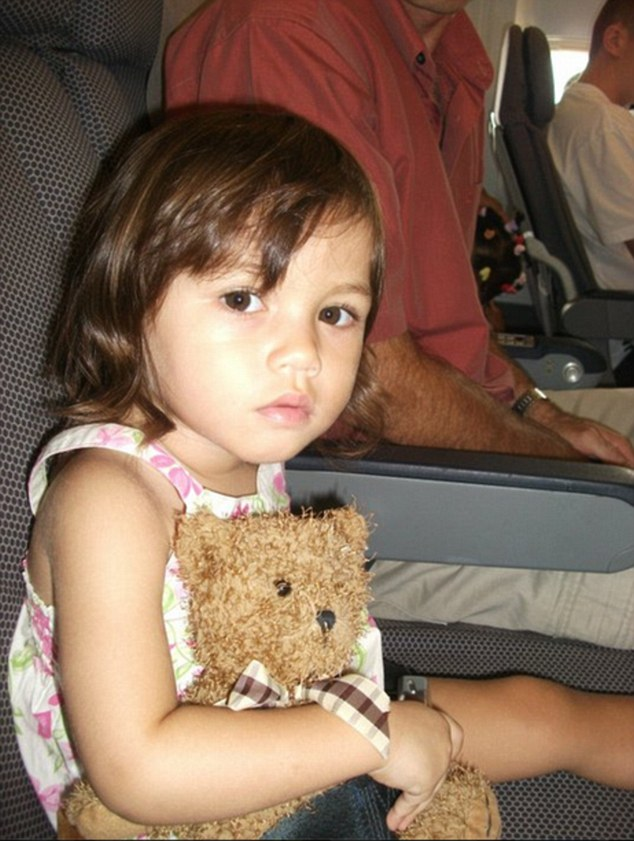 Natasha is back in Brisbane with her father. She is pictured on a plane before she was moved from Australia