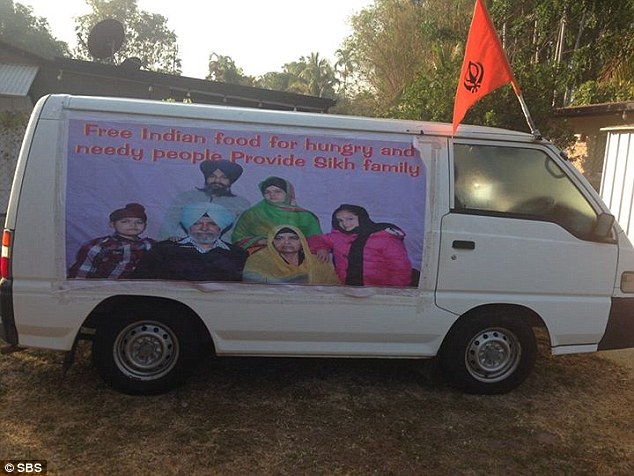 The van is decorated with a banner: 'Free Indian food for hungry and needy people, Provide Sikh family'