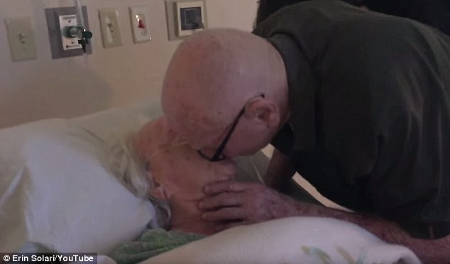 Still so in love: Howard is seen kissing his dying wife after the song is over