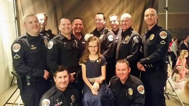 Officers from the Chandler and Gilbert police departments recently took one of the daughters of fallen Chandler officer Bryant Holmes to a father-daughter dance. (Source: Gilbert Police Department)