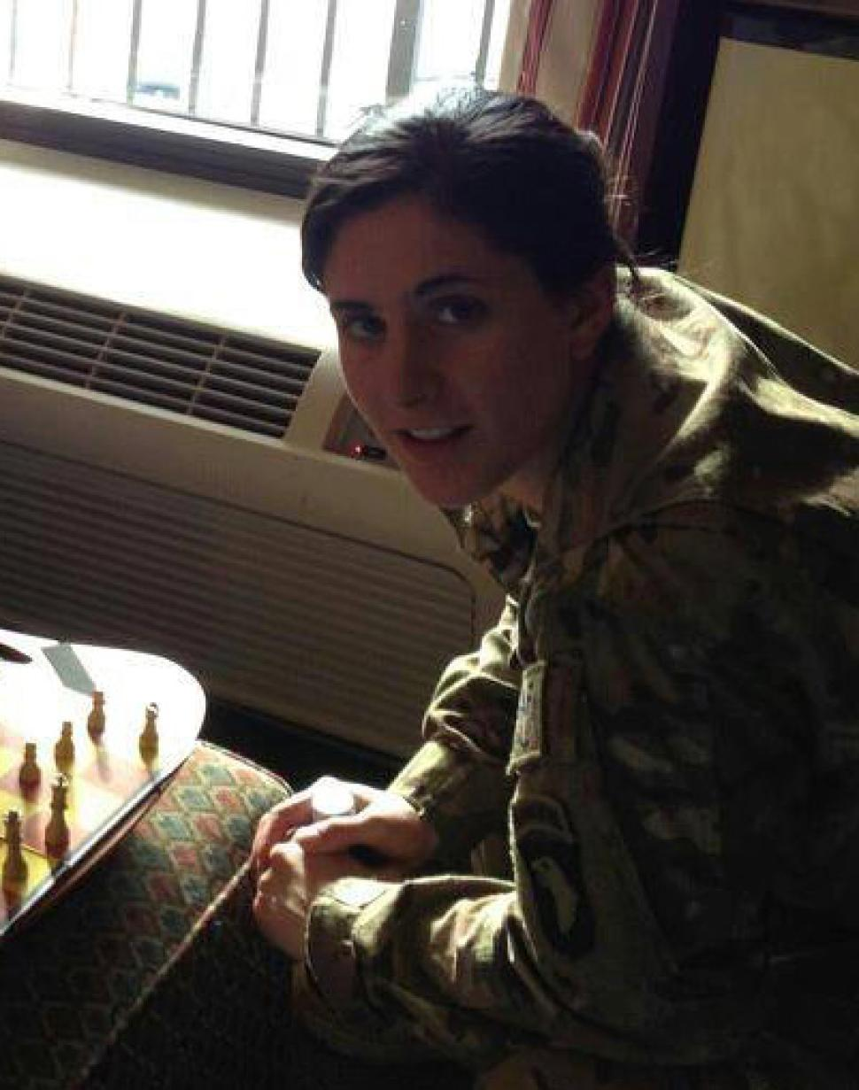 Capt. Kristen Griest is pictured playing chess.