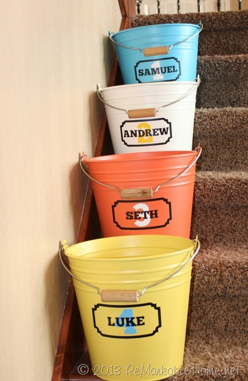 "Add some ""crap buckets"" to your stairway to keep track of all the stray things family members leave around the house."