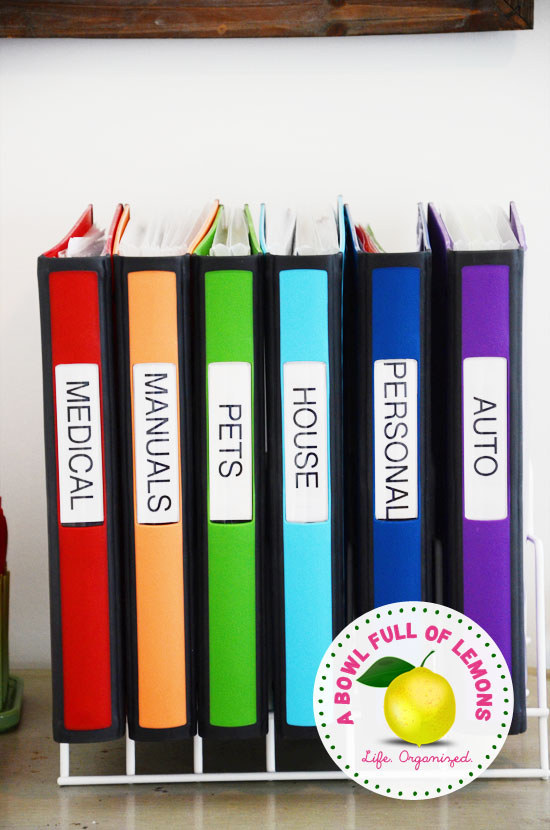 Use a kitchen baking sheet organizer to hold binders filled with important information.