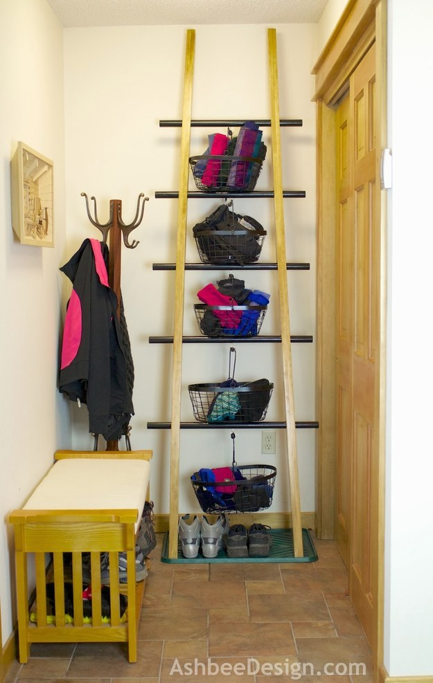 Hang baskets from the rungs of a ladder to store mittens, scarves, or umbrellas.