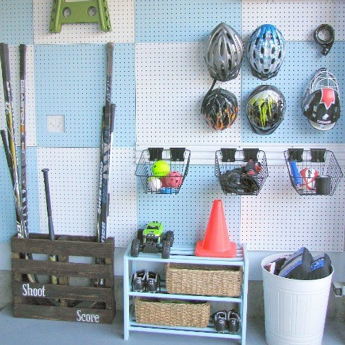 An easy way to organize your garage = covering a wall with peg boards.