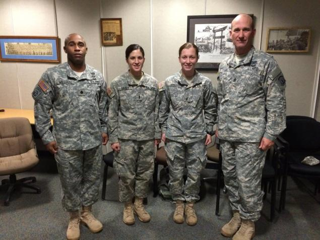 Capt. Kristen Griest (left) was pictured with fellow military police officers in December.
