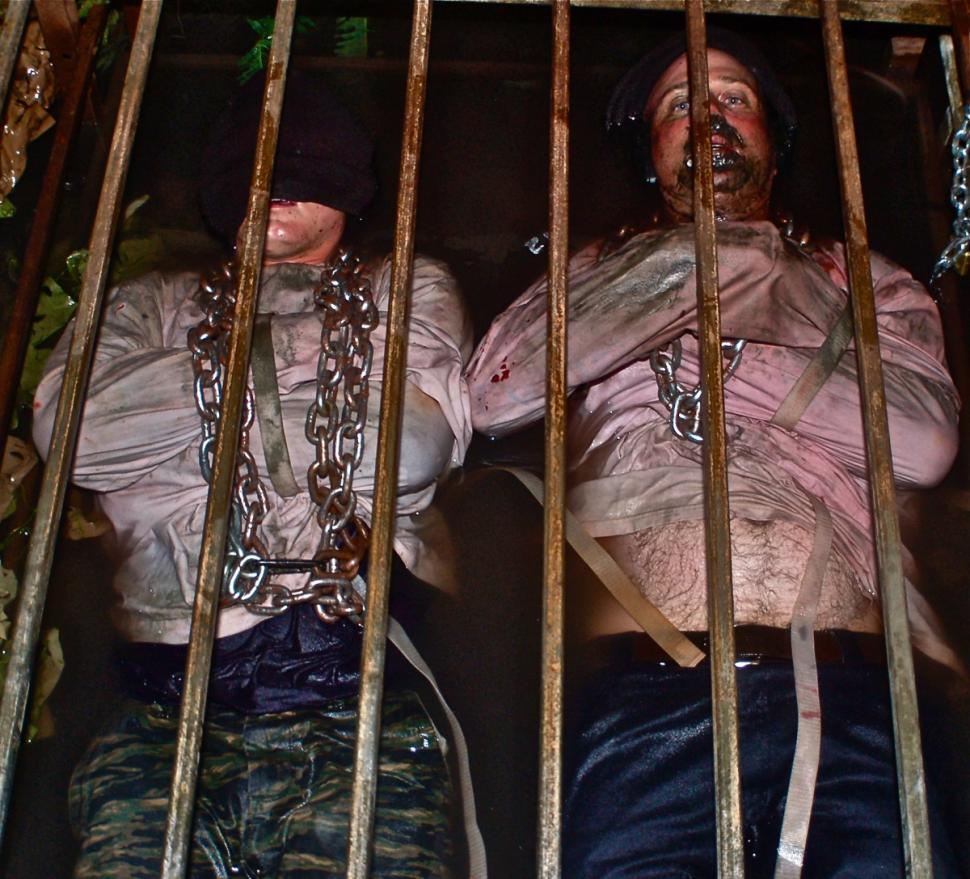 Two visitors are tied up in a cage at the McKamey Manor, in San Diego, California.