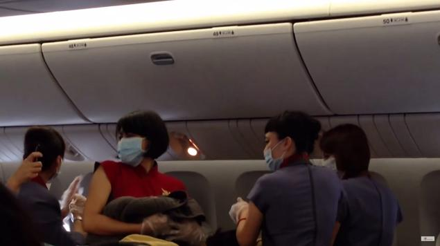 Travelers watched as a woman gave birth in the middle of a Taiwan to L.A. flight last Thursday.