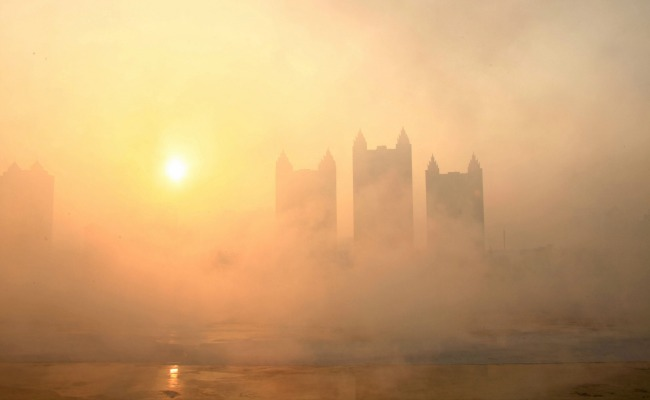 Real city covered by smog.