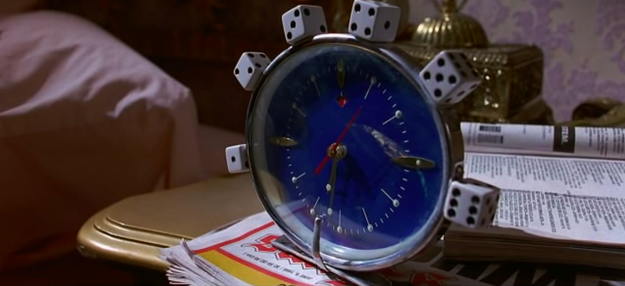 The Wormwoods' alarm clock is decorated with dice.