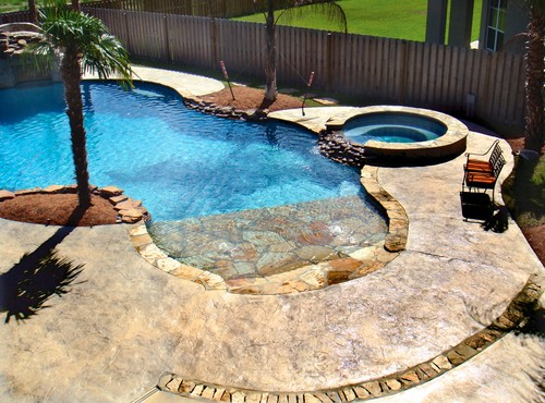 Create A Haven At Home With These Scenic Beach Entry Pool