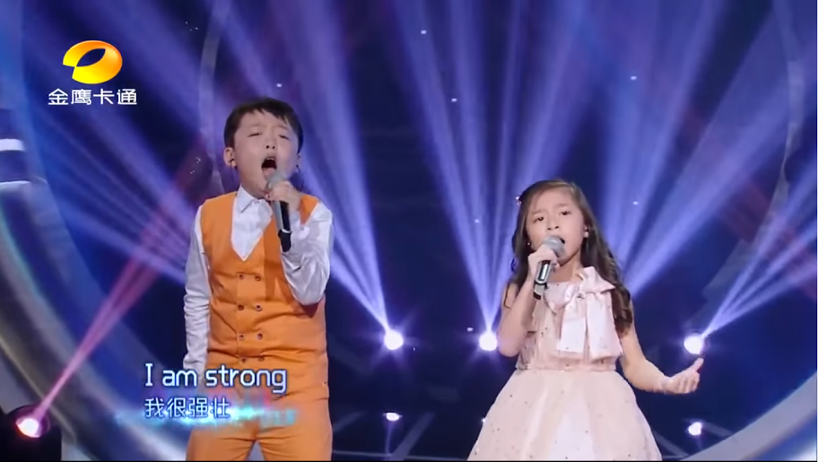 two chinese kids performed josh groban s you raise me up and the
