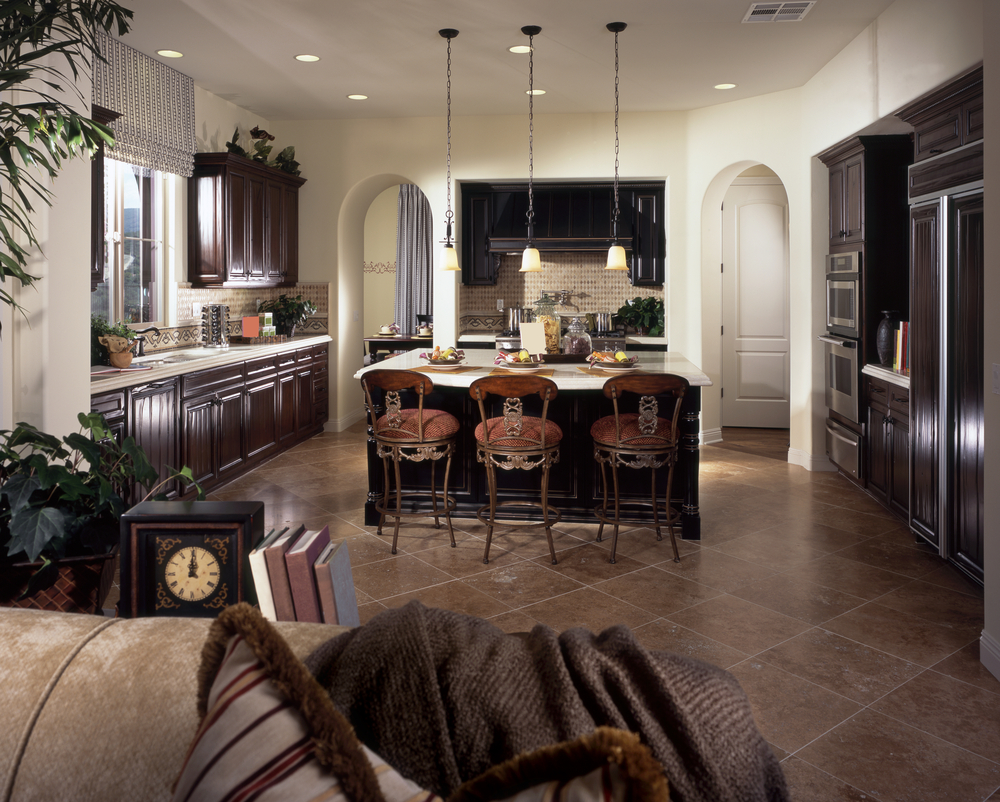 Large Kitchen With White Walls, Arched Doors, Dark Cabinetry, White Counter  Tops And