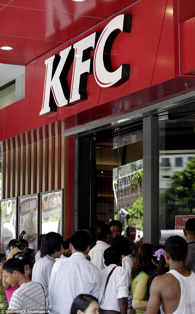 Worth the wait?: People line up to buy fried chicken outside a Kentucky Fried Chicken branch in Asia (stock image)