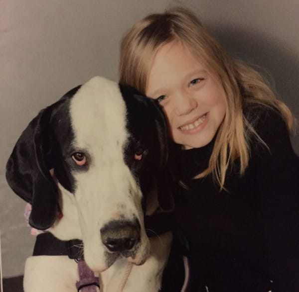 In 2015, life improved drastically for this incredible little girl. Bella met George the Great Dane, and the two formed an immediate bond.