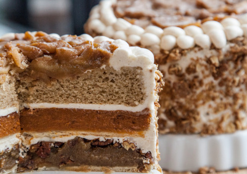 This pie-cake hybrid combines an apple upside-down cake, a pumpkin pie, and a pecan pie. Oh, and the whole thing is smothered with cinnamon buttercream frosting. Life is going to be okay.