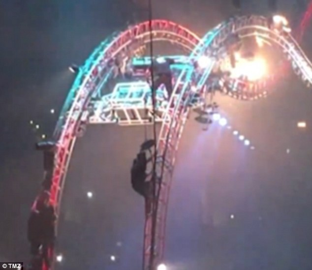 We are the road Crue: Tommy Lee had to be rescued after his drum roller coaster broke down at the group's final show in Los Angeles on New Year's Eve