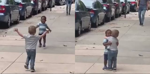 toddler best friends hugging