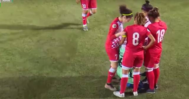 Opposing Team Hurdles Around Player with Loose Hijab